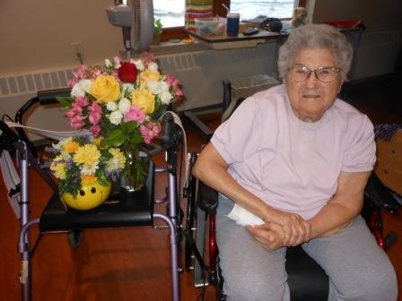 Bernice LeGarde is pictured here with the beautiful flowers she received on Valentine's Day.