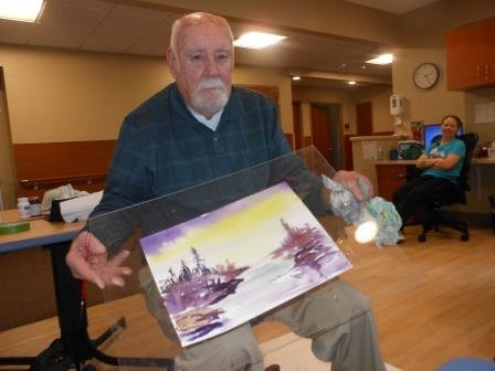 The residents enjoyed a painting demonstration by John Franz.